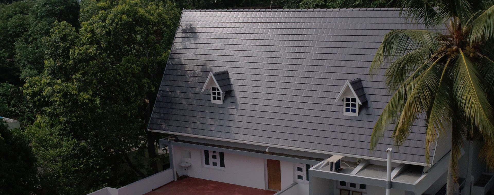 Plano dark grey concrete roof tile house image