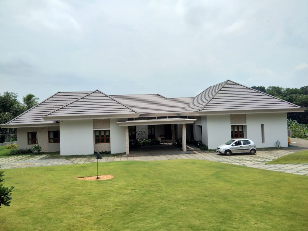 Plana - Brown BMI monier flat clayrooftile house image with car shed
